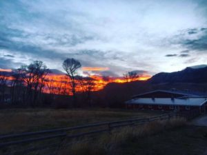 Sunrise by Trout Creek Ranch barn near Cody,WY