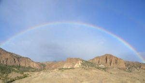 Full rainbow over Logan Mountain and Shoshone National Forest